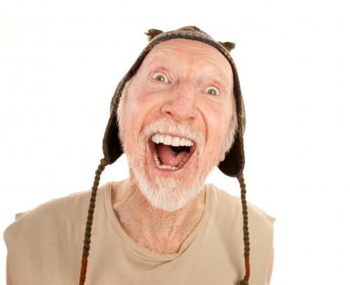 laughing-senior-man-in-knit-cap